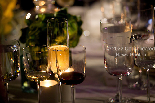 """Wine glasses sit on a table during the State Dinner with United States President Barack Obama and Angela Merkel, Germany's chancellor, on the South Lawn at the White House in Washington, D.C., U.S., on Tuesday, June 7, 2011. Obama said he and Merkel agreed that the debt crisis in Europe """"cannot be allowed to put the global economic recovery at risk."""" .Credit: Andrew Harrer / Pool via CNP"""