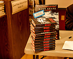 "July 26, 2017. Raleigh, North Carolina.<br /> <br /> A stack of books for Alan Gratz to sign. <br /> <br /> Author Alan Gratz spoke about and signed his new book ""Refugee"" at Quail Ridge Books. The young adult fiction novel contrasts the stories of three refugees from different time periods, a Jewish boy in 1930's Germany , a Cuban girl in 1994 and a Syrian boy in 2015."