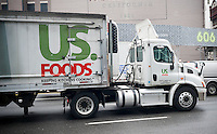 A US Foods delivery truck in the Soho neighborhood of New York on Monday, December 12, 2016. Because of a perceived relaxing by the Federal Trade Commission because of the new administration the Sysco-US Foods merger, which was stopped last year, may resurface. (© Richard B. Levine)