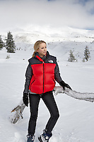 Woman near Timberline Lodge in winter with Mt. Hood.Oregon