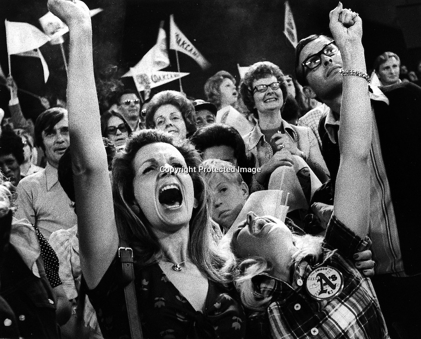 WIVES CHEER: Sandy Bando (wife of Sal) and Linda Tenace (wife of Gene) cheer their husbands during 1974 World Series in Oakland. (photo/Ron Riesterer)