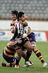 Niva Ta'auso is taken by the Bay defence during the Air NZ Cup rugby game between Bay of Plenty & Counties Manukau played at Blue Chip Stadium, Mt Maunganui on 16th of September, 2006. Bay of Plenty won 38 - 11.
