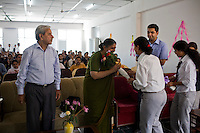 As the dean (left) looks on, Dr. Vandana accepts a bouquet of flowers presented to her by the students of a University in Solan, Himachal Pradesh, India, on 7th September 2009...Dr. Vandana Shiva, the founder of Navdanya Foundation and Bijavidyapeeth, is a physicist turned environmentalist who campaigns against genetically modified food and teaches farmers to rely on indigenous farming methods.. .Photo by Suzanne Lee / For The National