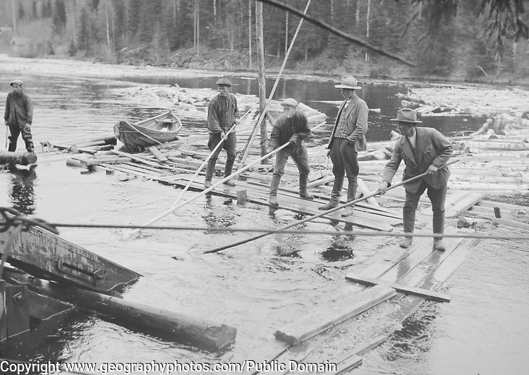 Men separating logs in a river, Finland 1920s-1930s