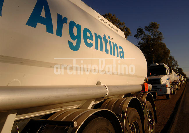 Trucks with fuel are stopped in a blockade in 9 de Julio, Buenos Aires province, Argentina.With thousands of protesters blocking roads and people rushing to withdraw their savings, this country at times seems like it's nearing the kind of economic collapse that sent more than half of Argentines into poverty seven years ago...