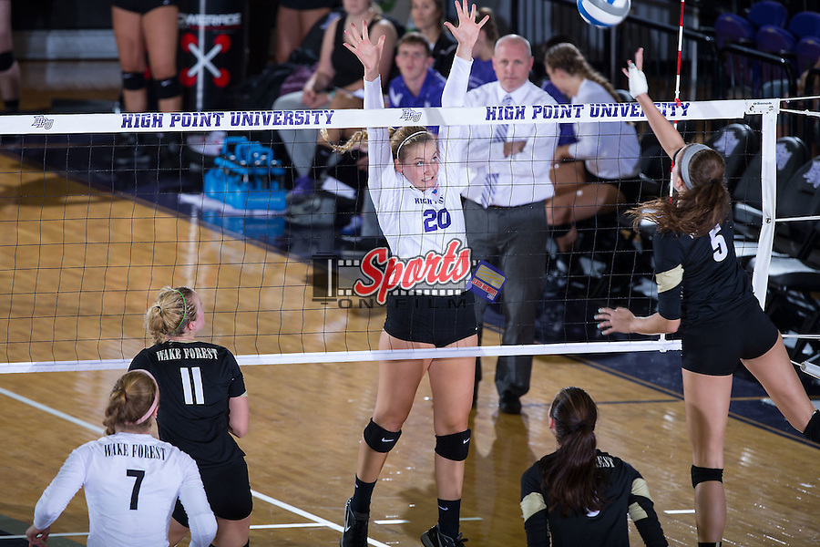 Haley Barnes (20) of the High Point Panthers attempts to block a shot during the match against the Wake Forest Demon Deacons at the Panther Invitational at the Millis Athletic Center on September 12, 2015 in High Point, North Carolina.  The Demon Deacons defeated the Panthers 3-1.   (Brian Westerholt/Sports On Film)