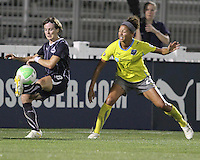 Sonia Bompastor #8 of the Washington Freedom  hooks the ball over Estelle Johnson #24 of the Philadelphia Independence during a WPS match on August 4 2010 at the Maryland Soccerplex, in Boyds, Maryland.Freedom won 2-0.
