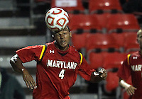 COLLEGE PARK, MD. - AUGUST 20, 2012:  Kyle Roach (4) of  the University of Maryland heads the ball away against Penn State during an NCAA match at Ludwig Field, in College Park, Maryland on August 20. The game ended in a 2-2 tie.