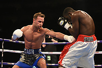 Felix Cash (blue/silver shorts) defeats James Hagenimana during a Boxing Show at The O2 on 3rd February 2018