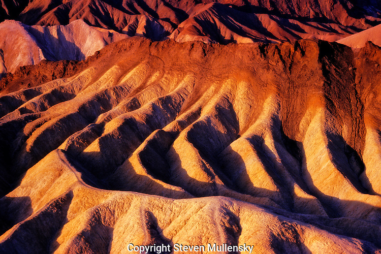 Zabriskie Point is a section of Death Valley National Park (in the United States) noted for its erosional landscape. The terrain is referred to as badlands because it is very difficult to grow plants there. It is composed of sediments from Furnace Creek Lake, which dried up 5 million years ago ? long before Death Valley came into existence. The landscape is in danger of being eroded away due to a nearby diversion of a water channel. he name Zabriskie comes from Christian Brevoort Zabriskie, who in the early 20th century was the vice-president and general manager of the Pacific Coast Borax Company, whose famous Twenty mule teams were used to transport borax from the company's mining operations in Death Valley.