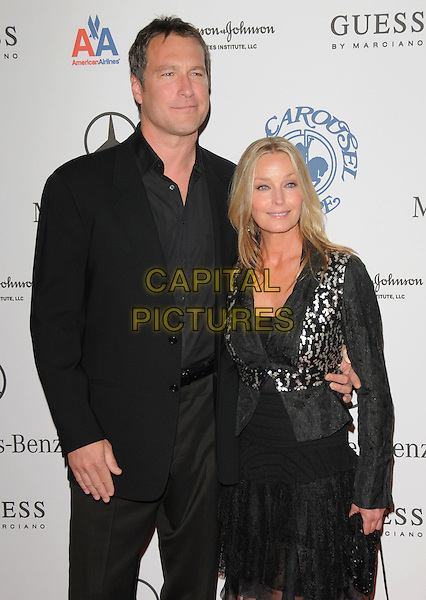JOHN CORBETT & BO DEREK .attends The 30th Anniversary Carousel of Hope Ball Presented by Mercedes-Benz held at The Beverly Hilton Hotel in Beverly Hills, California, USA,.October 25th 2008..half length black suit shirt dress jacket .CAP/DVS.©Debbie VanStory/Capital Pictures