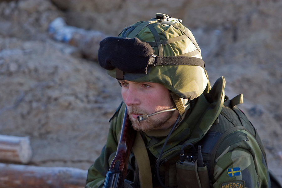 Kamenka, Karelia, Russia, 14/12/2007..A Swedish soldier in the trenches during Snezhinka [Snowflake] 2007, a joint live fire training exercise for Russian and Swedish motorised infantry in which they play the roles of a combined peace-keeping force enforcing a demilitarised zone in a warring region.