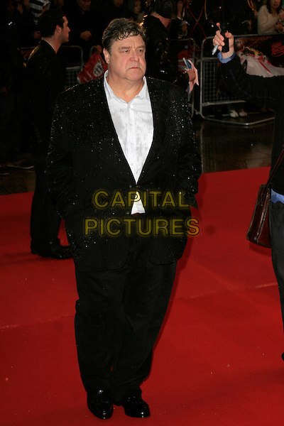 "JOHN GOODMAN.Arriving at the ""Speed Racer"" UK film premiere, Empire Leicester Square, London, England..April 28th 2008.full length black suit hands in pockets wet raining .CAP/AH.©Adam Houghton/Capital Pictures."