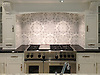 Arabella, a hand cut stone mosaic, shown in Thassos and Carrara.<br /> -photo courtesy of Klaffs in Scarsdale