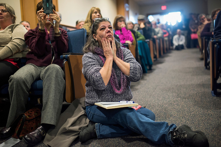 UNITED STATES - MARCH 16: Lillian Potter-Saum listens to Sen. Joe Manchin, D-W.Va., conduct a town hall meeting at the WVU Robert C. Byrd Health Sciences Center in Martinsburg, W.Va., March 16, 2017. Much the discussion was regarding the American Health Care Act, the Republican's plan to repeal and replace the ACA. (Photo By Tom Williams/CQ Roll Call)