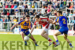 John Spillane and Dara Crowley Kenmare in action against Shane Ryan Rathmore in the Senior County Football Semi Final in Fitzgerald Stadium on Sunday.