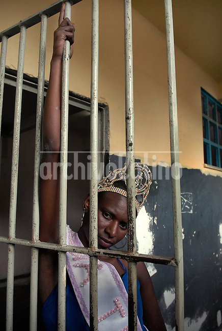Joyce da Silva, 25, poses before to return at her cell at the Talavera Bruce prison in Rio de Janeiro, Brazil, November 25, 2008. Joyce da Silva was elected the most beautiful among 15 contestants of three prisons in a beauty pageant held at the Talavera Bruce prison. The Miss Talavera Bruce Beauty Pageant is an important break from the routine life of about 330 female inmates in the maximum security prison. The Rio de Janeiro prison is a notorious Bangu area, where some of Rio's top drug traffickers are held. The fifth annual pageant, which the VivaRio non-governmental organization helps organize, tries to transform these dangerous criminals into beautiful, dazzling, beauty pageant hopefuls for one day. (Austral Foto/Renzo Gostoli)