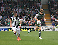David Wotherspoon beats Graham Carey to the header in the St Mirren v Hibernian Clydesdale Bank Scottish Premier League match played at St Mirren Park, Paisley on 18.8.12.