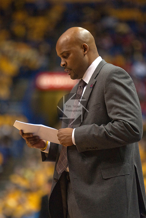 March 5,  2010              Missouri State head coach Cuonzo Martin checks his playbook notes in the first half.  Missouri State played Wichita State in Game 5 of the Missouri Valley Conference Tournament at the Scottrade Center in downtown St. Louis on Friday March 5, 2010.