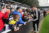 Wednesday, 23 April 2014<br /> Pictured: Ben Davies signing autographs for supporters.<br /> Re: Swansea City FC are holding an open training session for their supporters at the Liberty Stadium, south Wales,