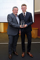Pictured L-R: Gary Richards presents Brandon Owen with the award for Under 18 winner Liam Cullen (NOT IN PICTURE) Saturday 27 May 2017<br /> Re: Swansea City FC Academy Awards Evening at the Liberty Stadium, Wales, UK