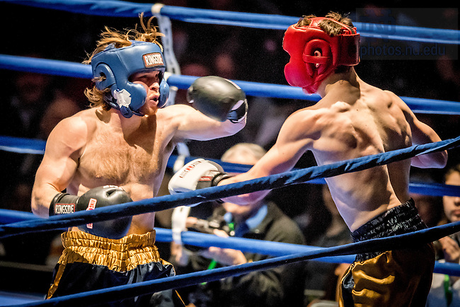 """March 3, 2017; Paddy """"The Notorious"""" Lawler (blue trunks) fights Jack """"Squad Socks"""" McDermott (gold trunks) in the 166lb. division. Lawler won in a unanimous decision. (Photo by Matt Cashore/University of Notre Dame)"""