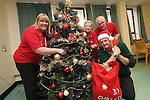 TATA Steel<br /> Keith Fallon from TATA Steel delivering christmas presents to staff of Age Cymru Ann Smith, Linda Goldsworthy and Glynn Thomas to hand out to patients at St Woolos Hospital in Newport.<br /> <br /> 17.12.13<br /> &copy;Steve Pope-FOTOWALES