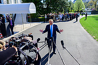 United States President Donald J. Trump makes remarks and answers questions from the media as he departs the South Lawn of the White House in Washington, DC for a day of activities in San Antonio, Texas and Houston, Texas on April 10, 2019.<br /> CAP/MPI/RS<br /> ©RS/MPI/Capital Pictures