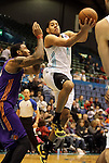 SIOUX FALLS, SD - FEBRUARY 12:  Mark Tyndale #11 from the Sioux Falls Skyforce eyes teammate Will Foster #44 while being guarded by Terrence Jennings #18 from the Iowa Energy in the first half of their game Tuesday night at the Sioux Falls Arena. (Photo by Dave Eggen/Inertia)