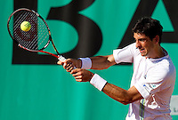 Thomaz Bellucci (BRA) (24) against Michael Llodra (FRA) in the first round of the men's singles. Thomaz Bellucci beat Michael Llodra 6-4 6-2 6-2..Tennis - French Open - Day 2 - Mon 24 May 2010 - Roland Garros - Paris - France..© FREY - AMN Images, 1st Floor, Barry House, 20-22 Worple Road, London. SW19 4DH - Tel: +44 (0) 208 947 0117 - contact@advantagemedianet.com - www.photoshelter.com/c/amnimages