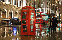 Red telephone box in the rain at Waterloo Place, St James. London on Saturday February 10th 2018<br /> CAP/ROS<br /> &copy;ROS/Capital Pictures