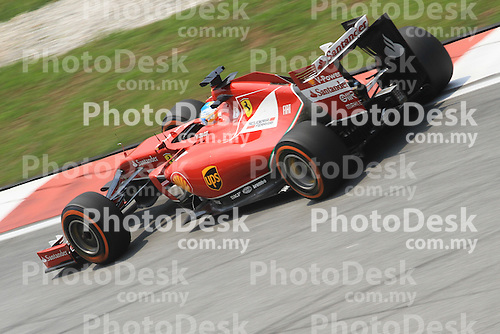 KUALA LUMPUR, MALAYSIA - MARCH 28: Ferrari driver Fernando Alonso of Spain in action during the second practice session during the Malaysia Formula One Grand Prix at the Sepang Circuit on March 28, 2014 in Kuala Lumpur, Malaysia. (Photo by PETER LIM/PhotoDesk.com.my)