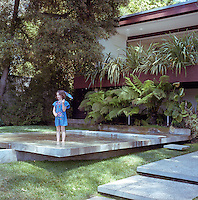 One of David Netto's daughters wading in the large shallow concrete reflecting pool