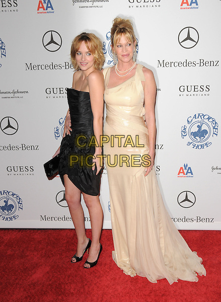 DAKOTA JOHNSON & MELANIE GRIFFITH .attends The 30th Anniversary Carousel of Hope Ball Presented by Mercedes-Benz held at The Beverly Hilton Hotel in Beverly Hills, California, USA,.October 25th 2008..full length strapless black dress pale yellow cream mother daughter family   pearl necklace long .CAP/DVS.©Debbie VanStory/Capital Pictures