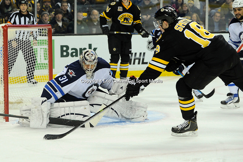 January 2, 2014 - Boston, Massachusetts, U.S. - Boston Bruins right wing Reilly Smith (18) shoots on Winnipeg Jets goalie Ondrej Pavelec (31)  during the NHL game between Winnipeg Jets and the Boston Bruins held at TD Garden in Boston Massachusetts.  Boston defeated Winnipeg 4-1 in regulation. Eric Canha/CSM