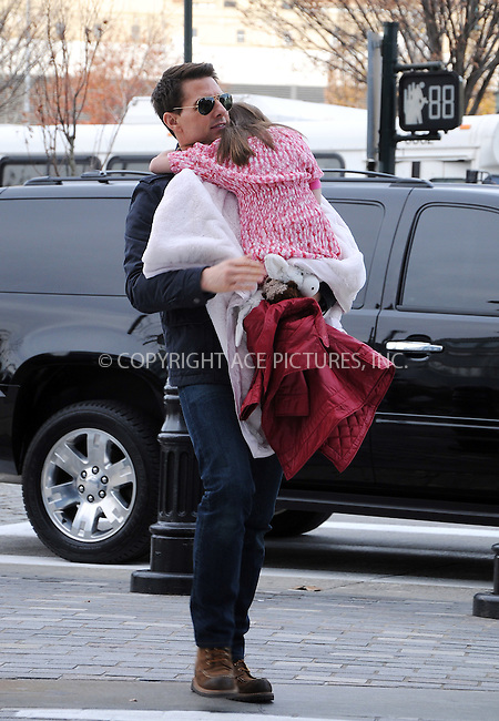WWW.ACEPIXS.COM . . . . .  ....December 16 2011, New York City....Actor Tom Cruise carries his daughter Suri Cruise to a waiting car on December 16 2011 in New York City....Please byline: CURTIS MEANS - ACE PICTURES.... *** ***..Ace Pictures, Inc:  ..Philip Vaughan (212) 243-8787 or (646) 679 0430..e-mail: info@acepixs.com..web: http://www.acepixs.com