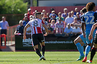 Billy Waters of Cheltenham scores his side's equalising goa; during the Sky Bet League 2 match between Cheltenham Town and Leyton Orient at the LCI Rail Stadium, Cheltenham, England on 6 August 2016. Photo by Mark  Hawkins / PRiME Media Images.