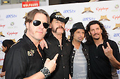 Don Jamieson of That Metal Show, Lemmy Kilmister and Phil Campbell of Motorhead, and Frank Bello of Anthrax walk the Black Carpet at the Revolver Golden Gods Awards presented by Epiphone held at Club Nokia in Los Angeles, CA USA on May 2, 2013. Photo © Kevin Estrada / IconicPix