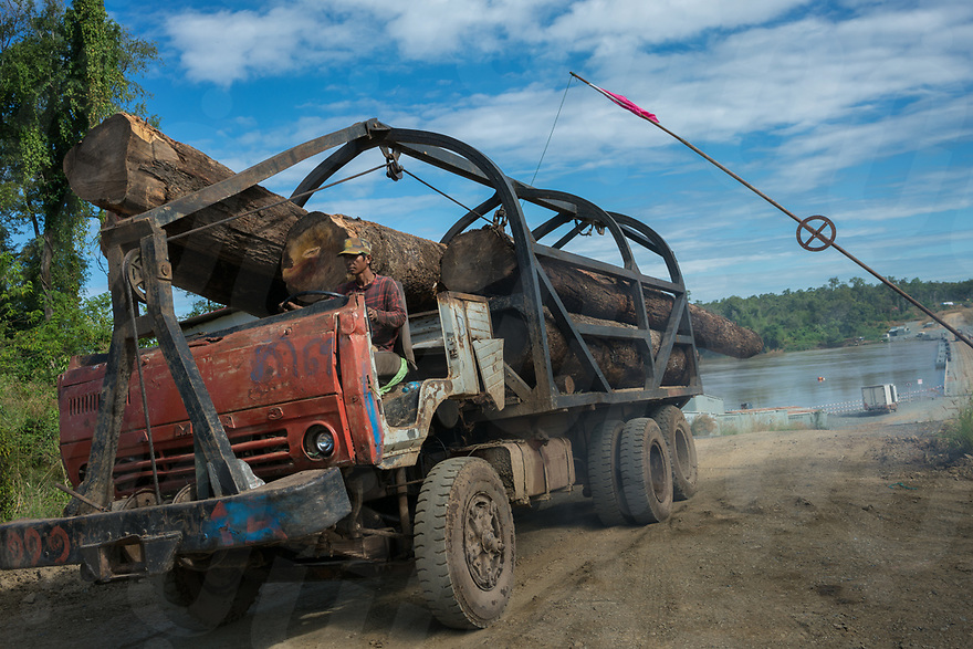 December 17, 2016 - Stung Treng (Cambodia). A truck carrying logs passes through a check point inside the construction site of the Lower Sesan 2 dam. Forest monitors allege that the construction of the dam led to large-scale deforestation of protected timber in the surrounding areas. © Thomas Cristofoletti / Ruom