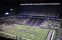 The Husky Band spells out their traditional Script Huskies during the pregame show in front of a packed house.