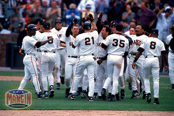 SAN FRANCISCO, CA - Jeff Kent of the San Francisco Giants celebrates with his teammates after beating the Colorado Rockies during a game at AT&T Park in San Francisco, California in 2000. Photo by Brad Mangin