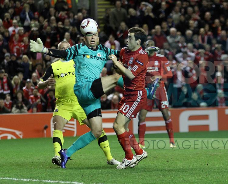 Liverpools Joe Cole tussles with Spartas Jaromir Blazek
