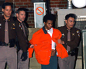 """Fairfax, VA - January 15, 2003 -- """"Beltway Sniper"""" suspect John Lee Malvo is escorted from Fairfax Court on January 15, 2003 where a Judge decided that he could be tried as an adult, thus becoming eligible to receive the death penalty for his crimes.<br /> Credit: Ron Sachs / CNP <br /> (RESTRICTION: NO New York or New Jersey Newspapers or newspapers within a 75 mile radius of New York City)"""