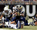 October, 17, 2010 - St Louis, MO -  Rams running back Steven Jackson (39) reaches for an extra yard after being hit by Chargers safeties Paul Oliver (27) and Eric Weddle (32) in the game between the St. Louis Rams and the San Diego Chargers at the Edward Jones Dome.  The Rams defeated the Chargers 20 to 17.