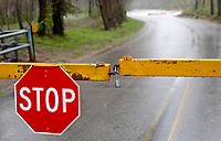 NWA Democrat-Gazette/DAVID GOTTSCHALK A gate is locked Tuesday, March 27, 2018, blocking access to the low water bridge on Ball Street in Johnson. Heavy rains in Northwest Arkansas caused closure of some streets.