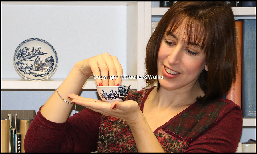 BNPS.co.uk (01202 558833)<br /> Pic:  Woolley&Wallis/BNPS<br /> <br /> Clare Durham from Woolley and Walllis with the the bowl and saucer.<br /> <br /> A tea bowl and saucer which were bought on eBay for £1,000 could sell at auction for 100 times that amount.<br /> <br /> The savvy collector took a punt on the items as he believed they could have been made by trailblazing English potter John Bartlam.<br /> <br /> Bartlam, who was originally was Staffordshire, was responsible for the first pieces of porcelain fashioned in America 250 years ago.<br /> <br /> Scientific tests have proved the tea bowl and saucer were made at Bartlam's factory in Cain Hoy, South Carolina between 1765 and 1769.