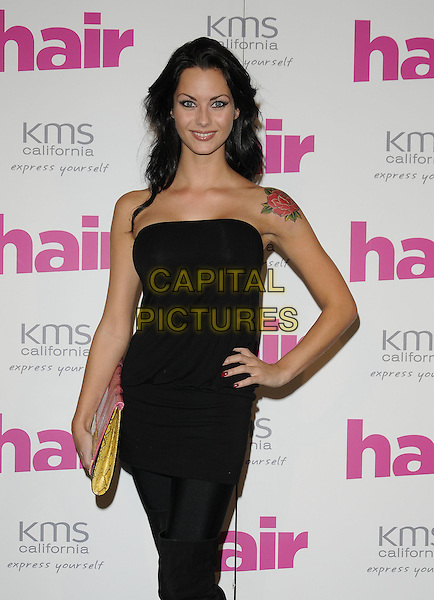 JESSICA-JANE CLEMENT .The Hair Magazine Awards, Grosvenor Place, London, England. .September 29th, 2009 .half length black tattoo strapless top rose tattoo shoulder leggings hand on hip yellow clutch bag dress.CAP/CAN.©Can Nguyen/Capital Pictures.