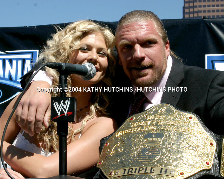 ©2004 KATHY HUTCHINS /HUTCHINS PHOTO.PRESS CONFERENCE TO ANNOUNCE WRESTLEMANIA 21.LOS ANGELES, CA.SEPTEMBER 22, 2004..TORRIE WILSON.TRIPLE H