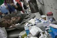 July 15, 2015 - Sa'dah, Yemen: The mother of Bashar Al Asadi struggles for her life at the local hospital after she was rescued from the rubble of a house building hit by a fighter jet from the Saudi-led coalition in the northern city of Sa'dah, the stronghold of the Houthi movement in Yemen. The family of Bashar was buried under the rubble during the attack. Two members of his family, the mother and his brother (not pictured) died from their injuries, while his sister (not pictured) survived. (Photo/Narciso Contreras)