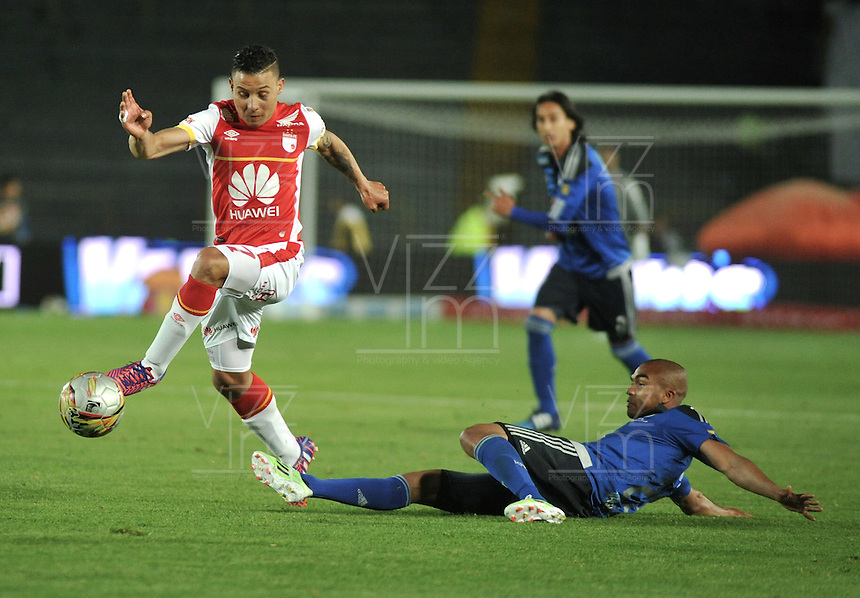 BOGOTA - COLOMBIA -14 -03-2015: Lewis Ochoa (Der.) jugador de Millonarios disputa el balón con Luis Arias (Izq.) jugador de Independiente Santa Fe, durante partido entre Millonarios e Independiente Santa Fe por la fecha 10 de la Liga Aguila I-2015, jugado en el estadio Nemesio Camacho El Campin de la ciudad de Bogota. / Lewis Ochoa (R) player of Millonarios vies for the ball with Luis Arias (L) player of Independiente Santa Fe, during a match between Millonarios and Independiente Santa Fe, for the  date 10 of the Liga Aguila I-2015 at the Nemesio Camacho El Campin Stadium in Bogota city, Photo: VizzorImage / Luis Ramirez / Staff.
